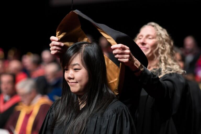 Graduand being hooded at Convocation