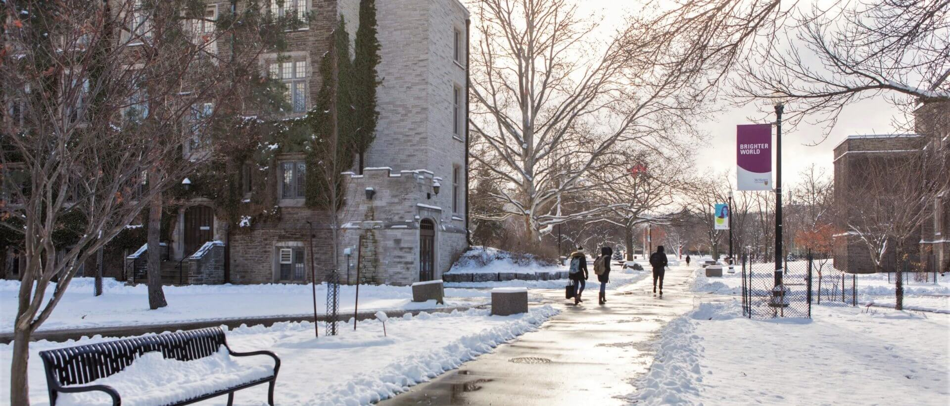 Student walking on campus in winter